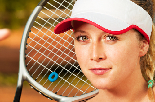 Close-up with face of young and beautiful woman tennis player